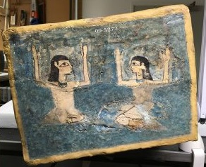 The foot of the lid of the coffin showing Isis and Nephthys in mourning gesture. Photo National Museum of Scotland.